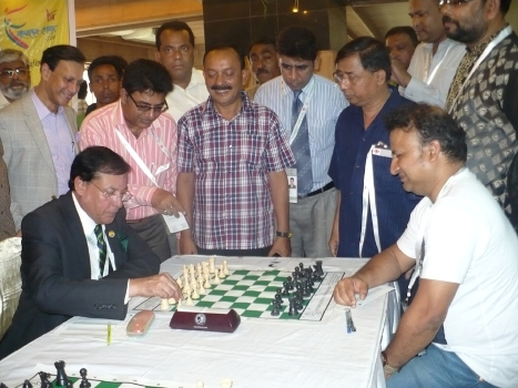 Syed Shahed Reza Secretary General of Bangladesh Olympic Association giving move against GM Niaz Murshed in the Inauguration of the Classical Chess Mixed Team