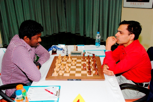 Former Under 16 world champion GM Adhiban shocked second seeded GM K Sasikiran in the ninth round