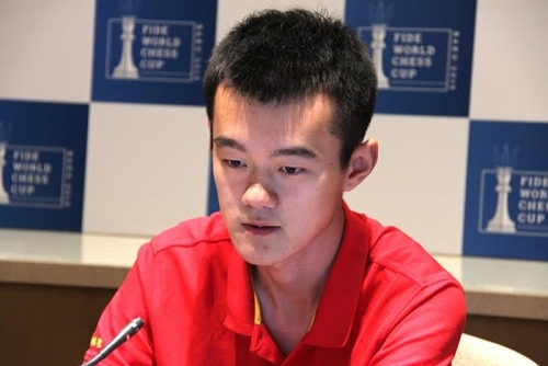 Ding Liren presenting his game in the live broadcast