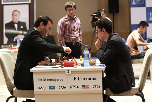 Dmitry Jakovenko observes the game between Shakhriyar Mamedyarov and Fabiano Caruana