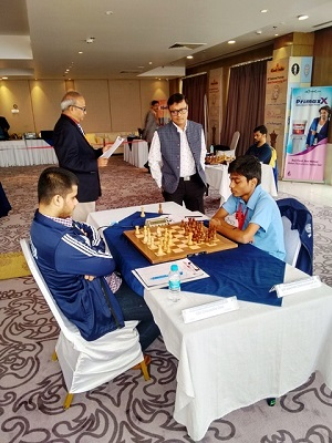 2. GM Dibyendu Barua is observing the game wherein Debashis Das dashed the hopes of Aravindh to win the title