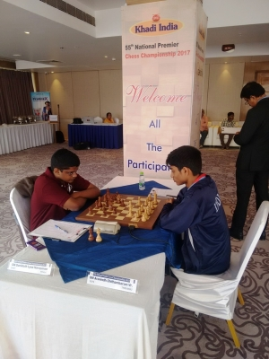 """ \""1. GM Aravindh Chithambaram consolidated the lead with a win over GM SL Narayanan\"""""