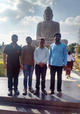 The players in front of 80 feet Budhha statue on the rest day