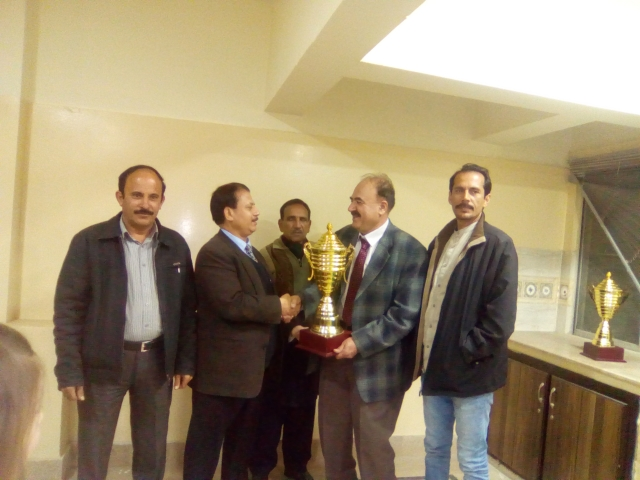 L-R Mr. Ishtiaq Ch. IM Lodhi Receiving Trophy Mr. Ghulam Abbas President CAP Mr. Abdul Aziz Khan President BCA presenting Trophy Mr. Waqar Ahmad Madni General Secretary Chess Federation of Pakistan