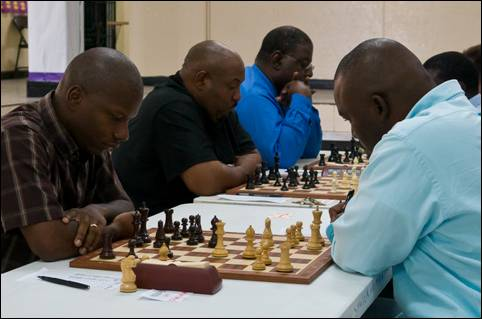 Ken Gibson (left) facing Chappel Whyms in the final round of the Bahamas National Championship. Gibson would win the encounter to earn the title. Photo by Bahamas Chess Federation.